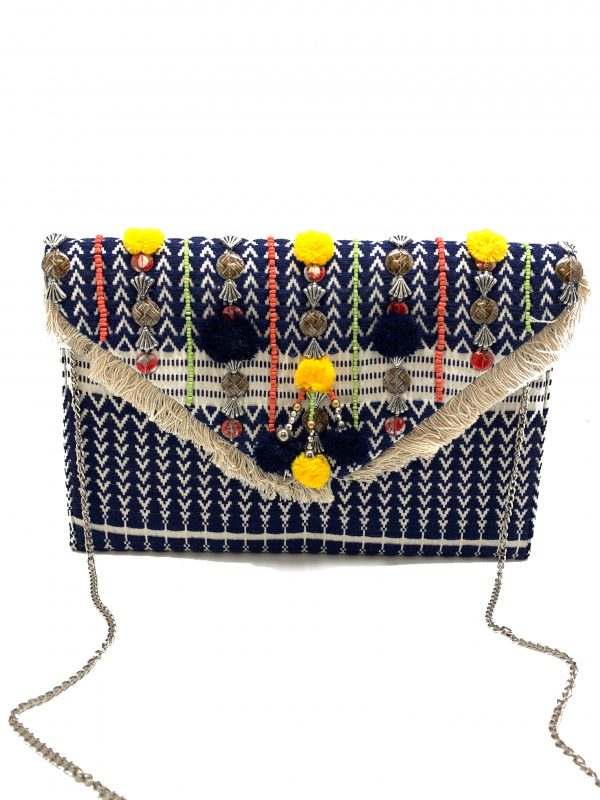 JACQUARD FABRIC CLUTCH WITH POMPOMS AND FRINGE