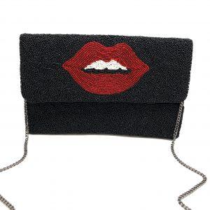 RED LIP BAG ON BLACK BACKGROUND