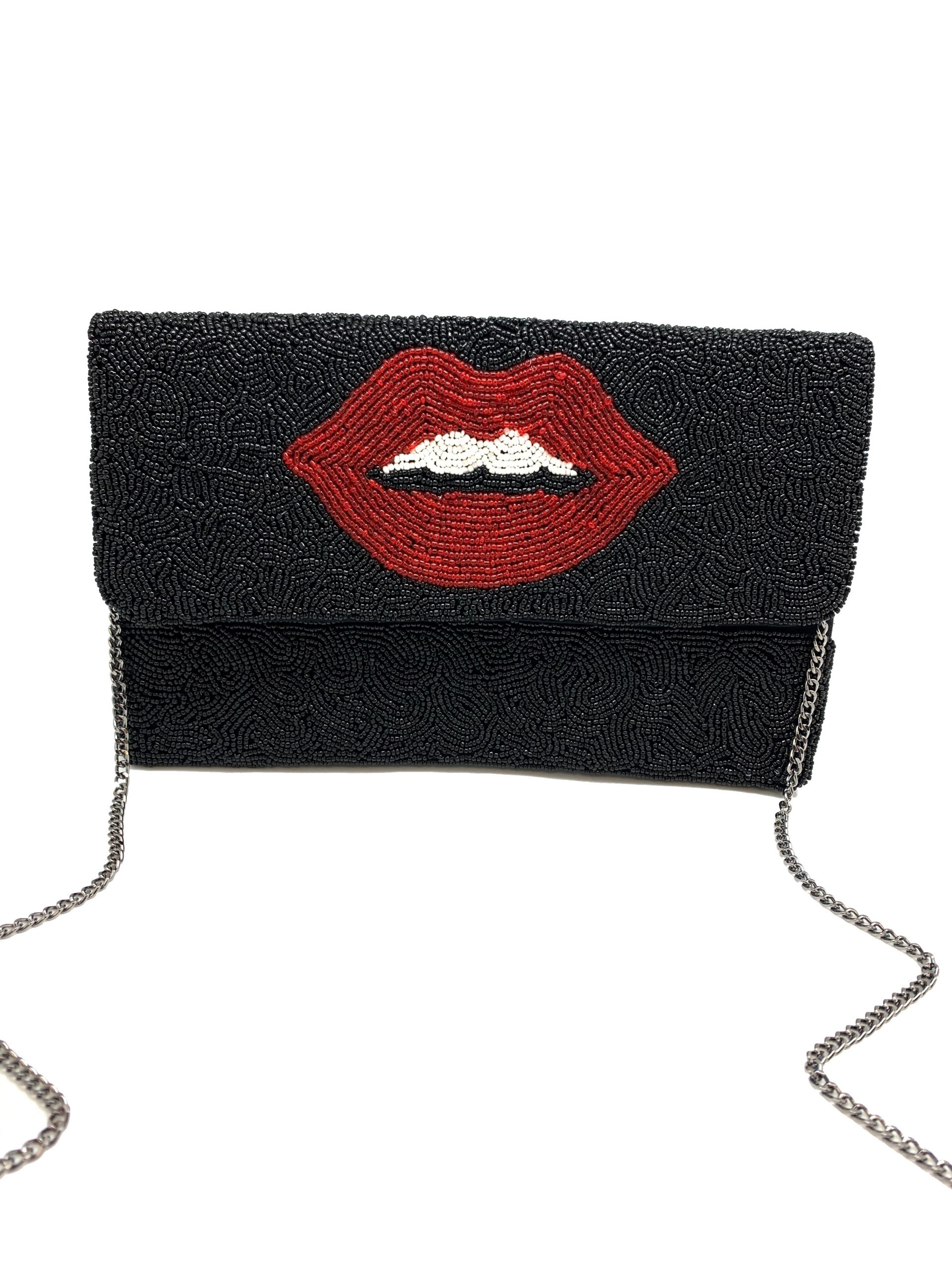 RED LIP BAG ON BLACK BACKGROUND